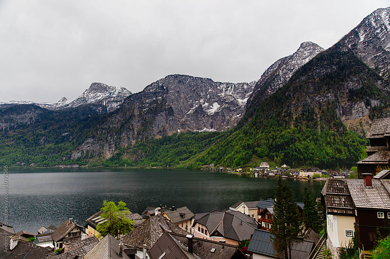 Remote Austrian village with calm lake in mountains by Andrey Pavlov for Stocksy United