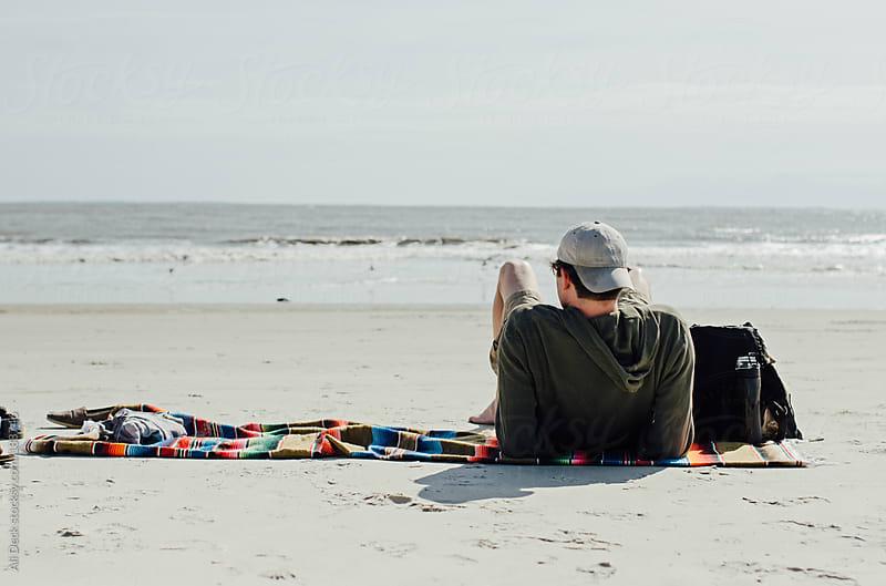 Man on a Beach by Ali Deck for Stocksy United