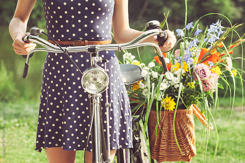 Girl With Old-Fashioned Bicycle and Flowers by VISUALSPECTRUM for Stocksy United