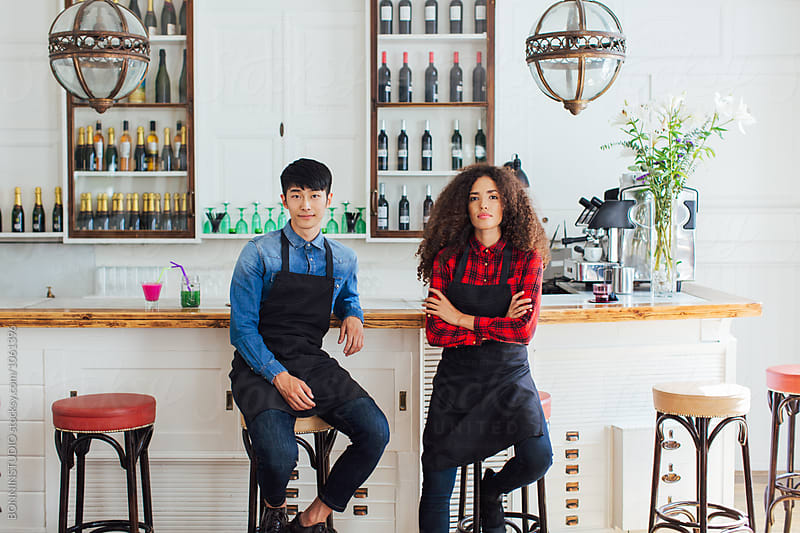 Portrait of cool workers in a nice coffee shop.  by BONNINSTUDIO for Stocksy United