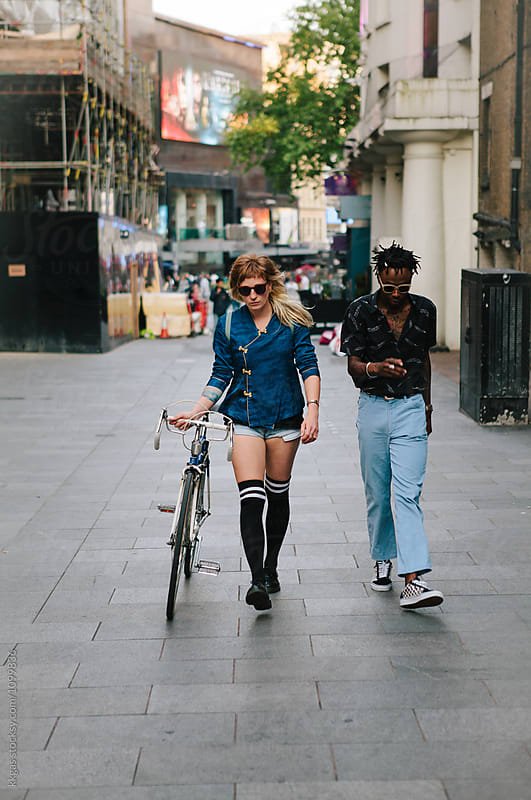 Attractive man and woman walking through london by kkgas for Stocksy United