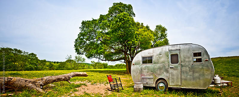 Old Travel Trailer on a Country Hillside by Shelly Perry for Stocksy United