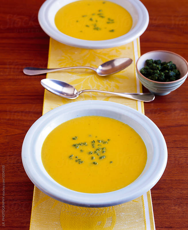 Pumpkin soup by J.R. PHOTOGRAPHY for Stocksy United