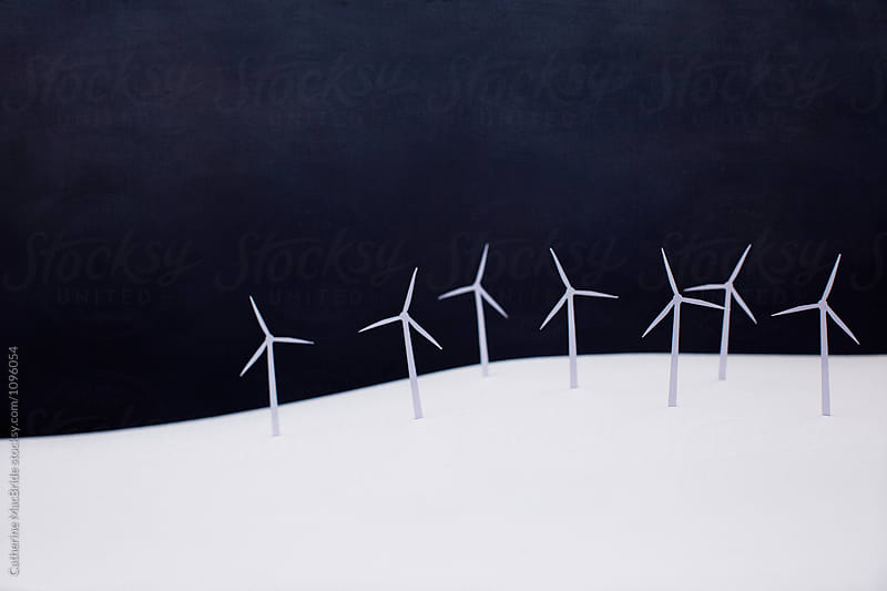 Modern paper landscape with paper wind turbines... by Catherine MacBride for Stocksy United