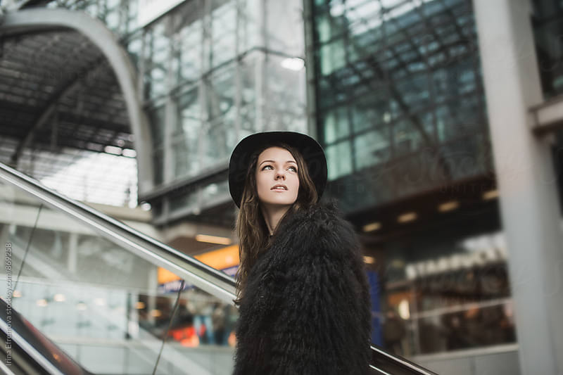 Attractive young woman in black on the railway station by Irina Efremova for Stocksy United