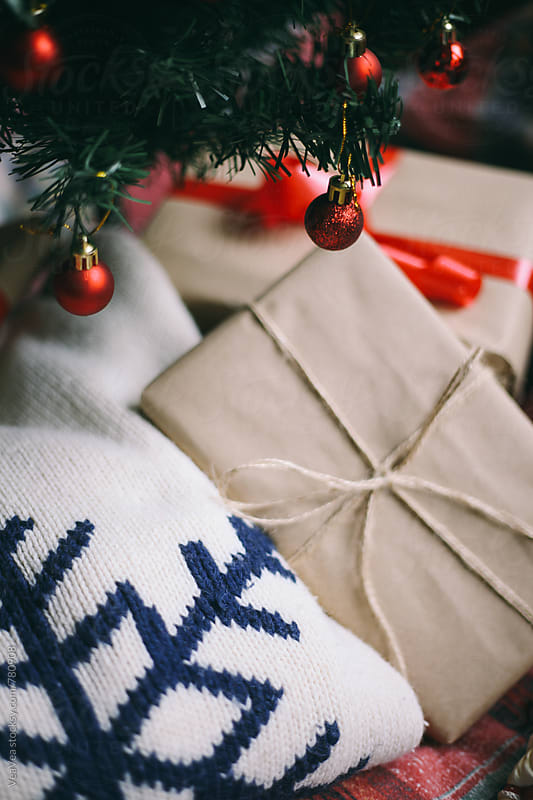 Christmas presents and Christmas tree on a natural light  by Marija Mandic for Stocksy United