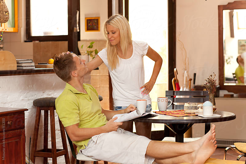 Young couple engaged in daily life at home. by Mosuno for Stocksy United
