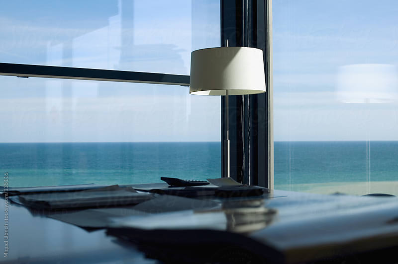 Office with a sea view by Miquel Llonch for Stocksy United