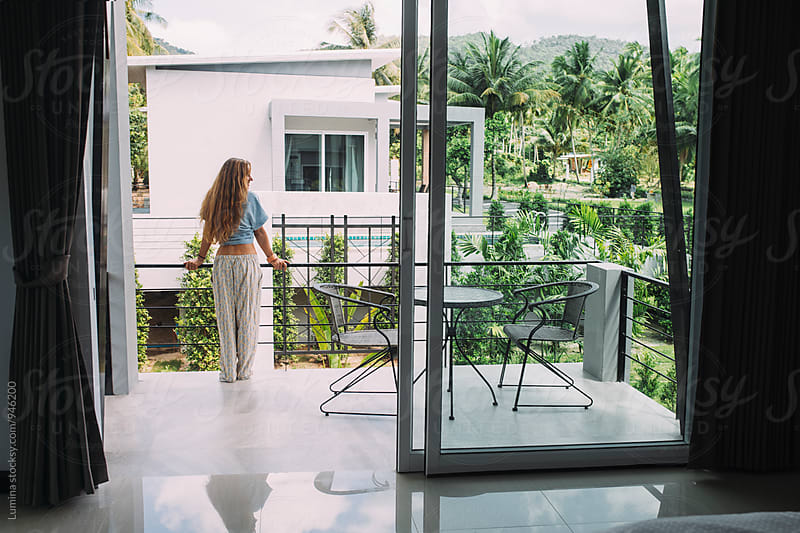 Woman Standing on the Balcony at Home by Lumina for Stocksy United