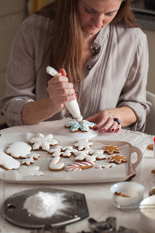 Preparing Christmas cookies by Jelena Jojic Tomic for Stocksy United