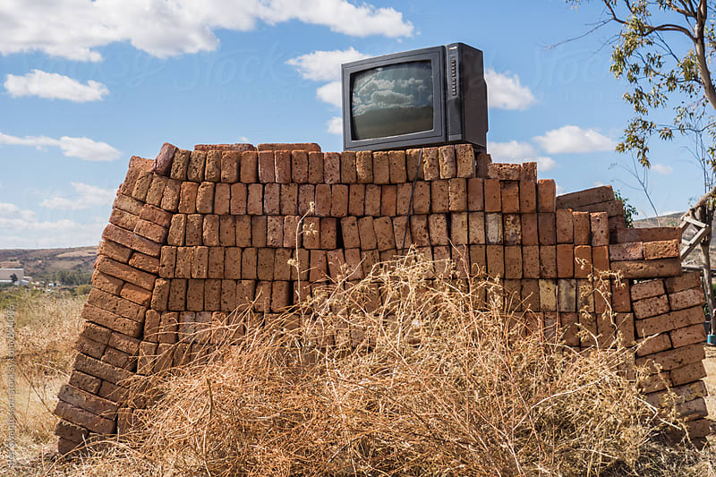 Vintage TV on top of pile of bricks by Per Swantesson for Stocksy United