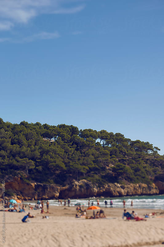 Group of people on the beach in summer time. by CACTUS Blai Baules for Stocksy United