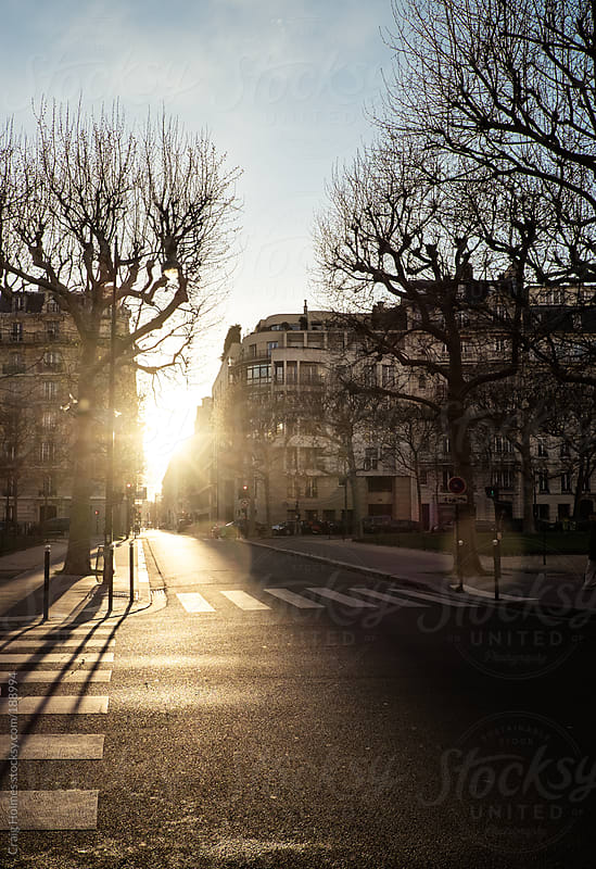 Parisian street scene at sunset. by Craig Holmes for Stocksy United