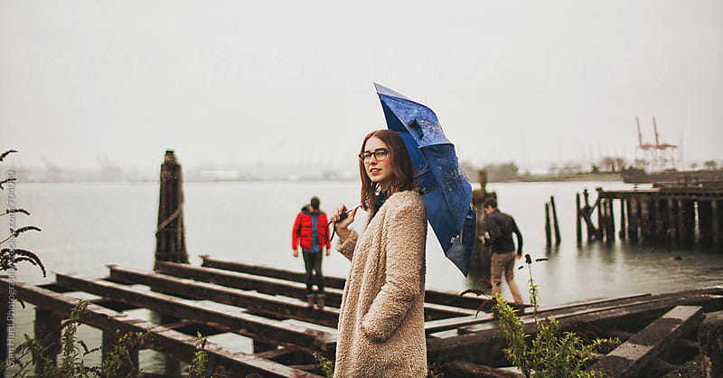 girl with blue umbrella by Sam Hurd Photography for Stocksy United