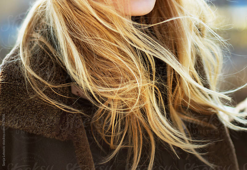 blond hair in the wind by Sonja Lekovic for Stocksy United
