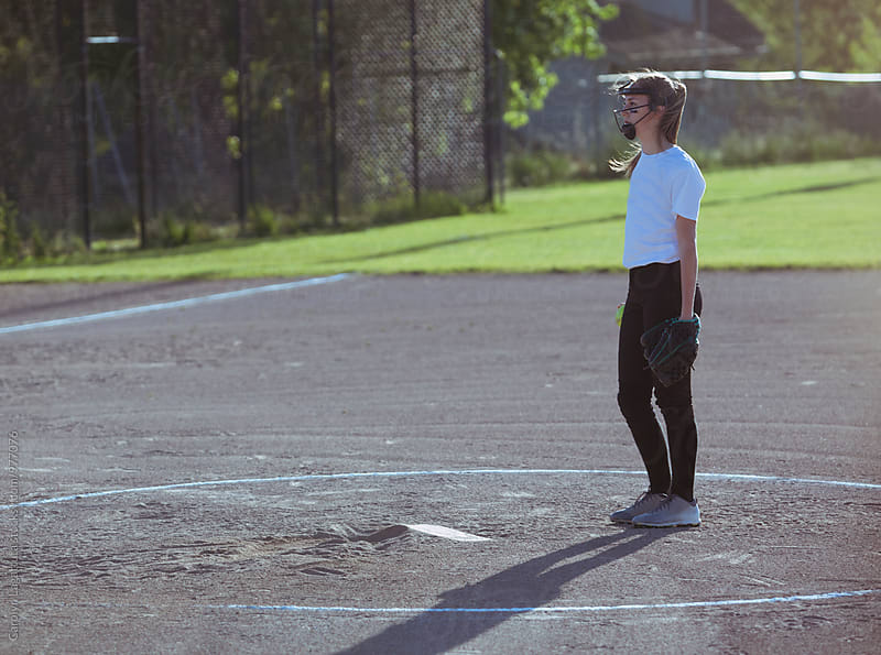 Teenage girl contemplating her next pitch in a softball game