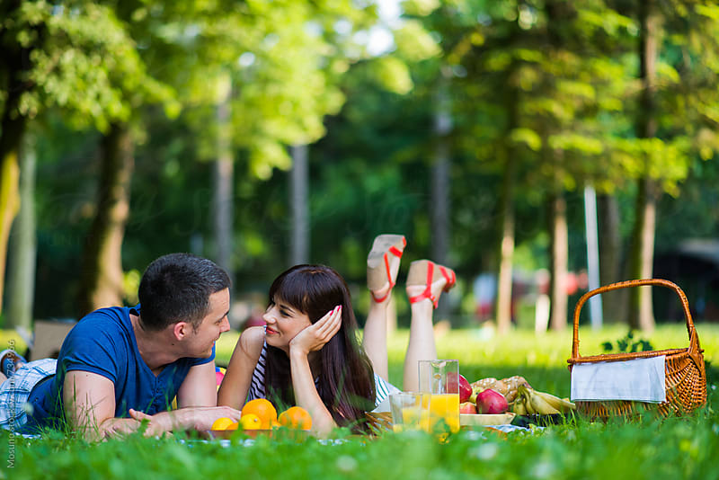Happy Couple Having Picnic in the Park by Mosuno for Stocksy United