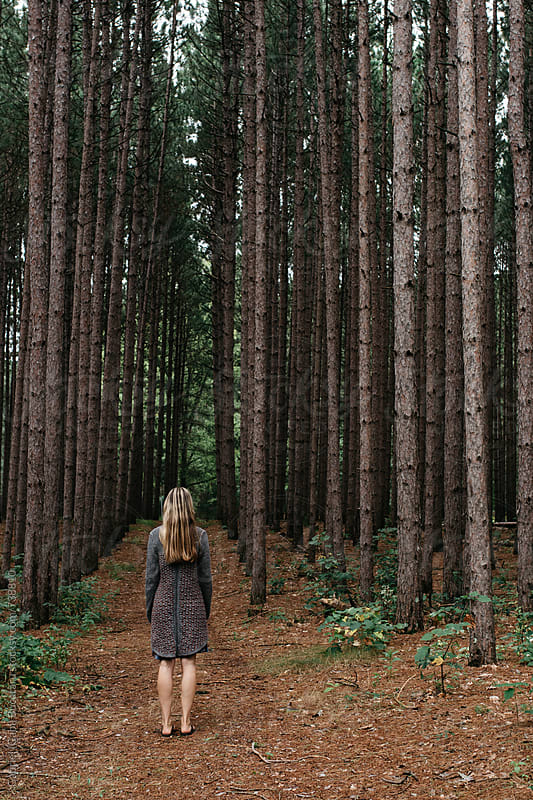 Woman in sweater standing in a pine forest by Gabriel (Gabi) Bucataru for Stocksy United