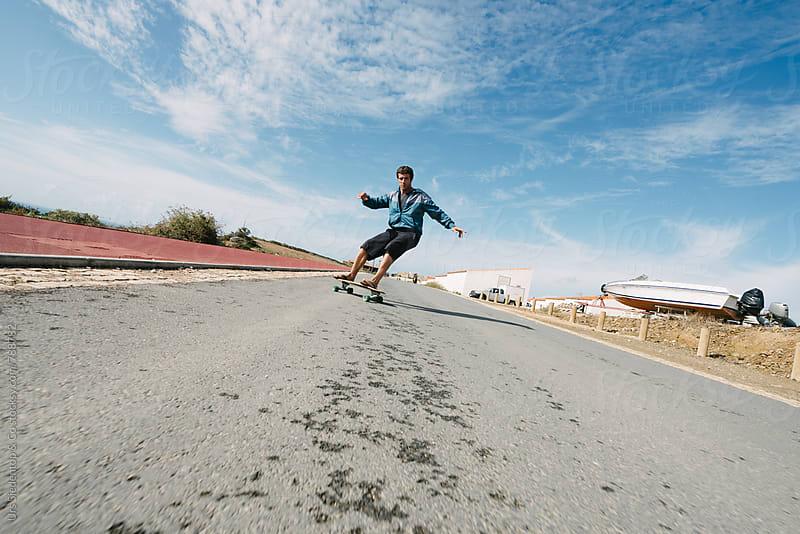 Flip flop downhill skateboarding by Urs Siedentop & Co for Stocksy United