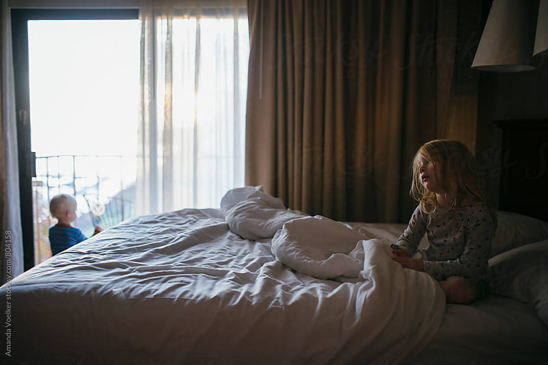 Two Young Children in a Hotel Room by Amanda Voelker for Stocksy United