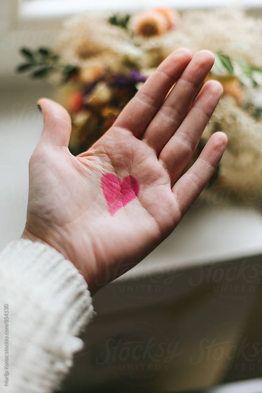 Pink heart on a female hand by Marija Kovac for Stocksy United