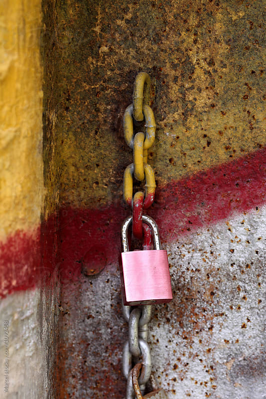 Love padlock on rusty old graffiti wall by Marcel for Stocksy United
