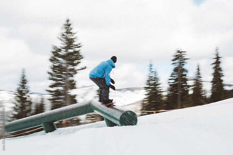 Snowboarder Grinding a Rail  by Jake Elko for Stocksy United