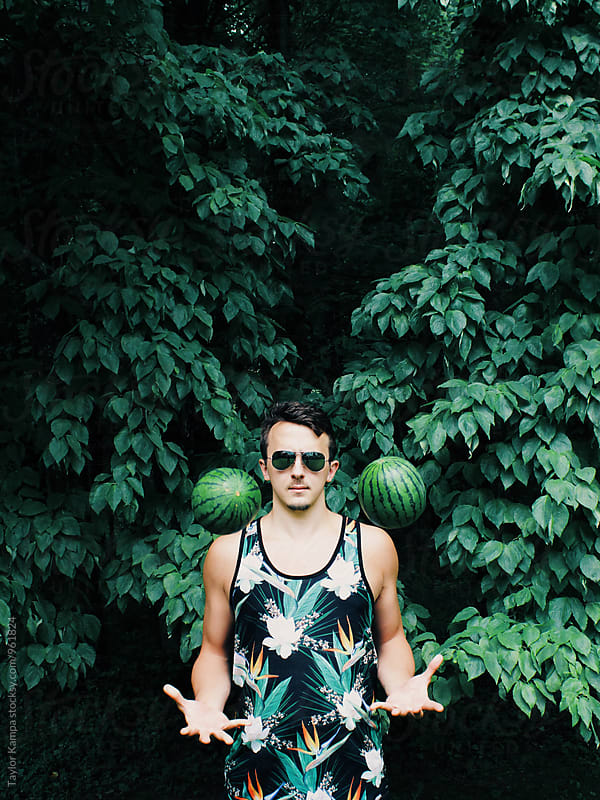 Man Tossing Watermelons by Taylor Kampa for Stocksy United
