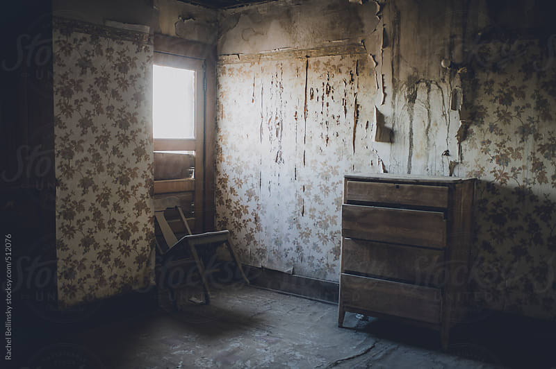 Creepy abandoned room with window by Rachel Bellinsky for Stocksy United