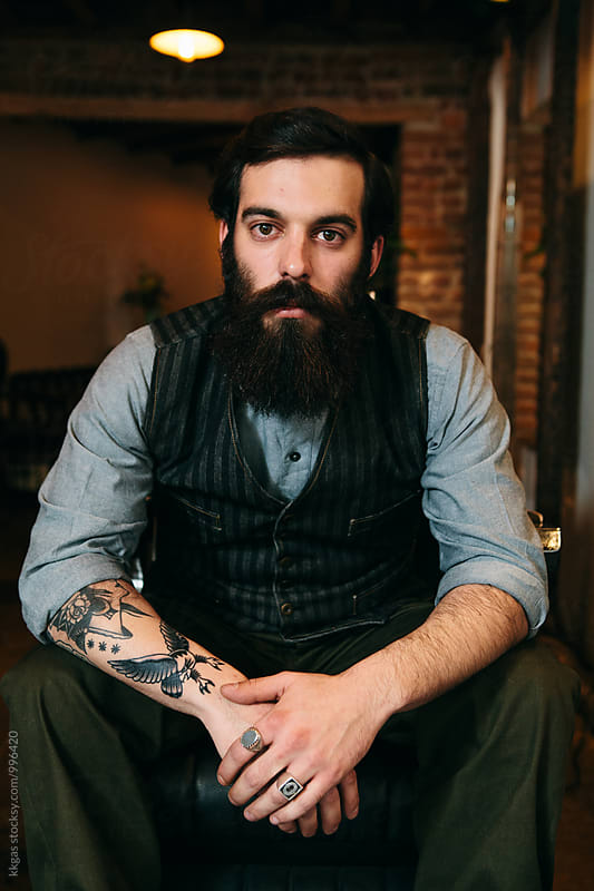 Elegant man with full beard  and tattoos in a barbershop by kkgas for Stocksy United