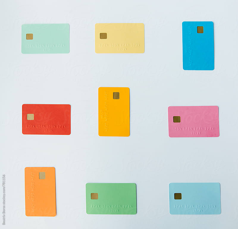 Arranged colored credit cards  by Beatrix Boros for Stocksy United