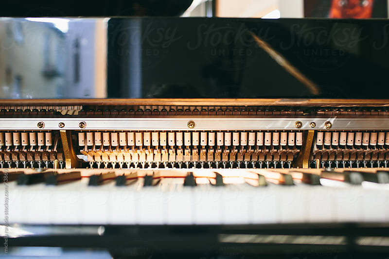 Keyboard and mechanics of a piano. by michela ravasio for Stocksy United