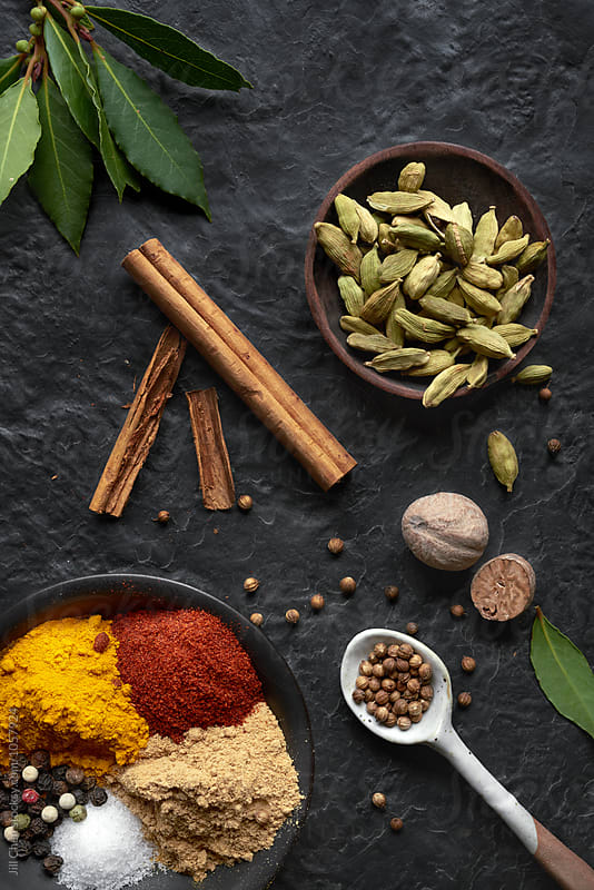 Indian spices on dark background  by Jill Chen for Stocksy United