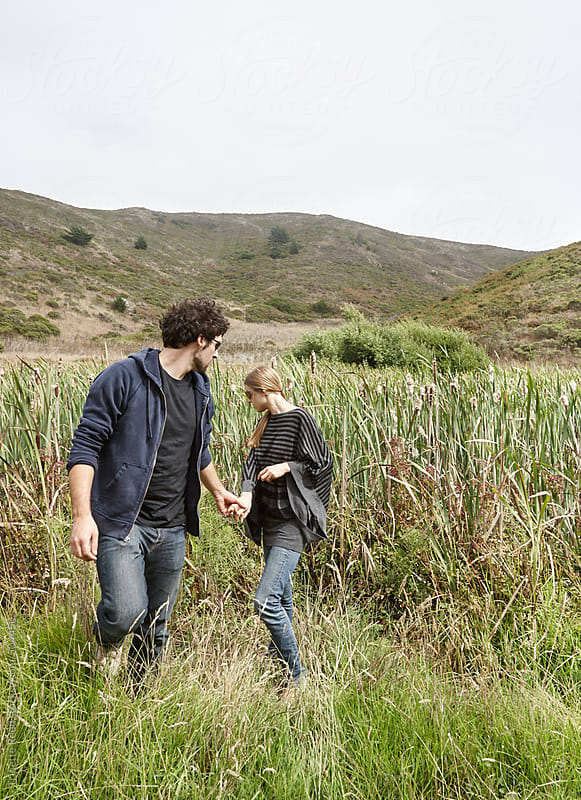 Couple exploring in nature in California  by Trinette Reed for Stocksy United