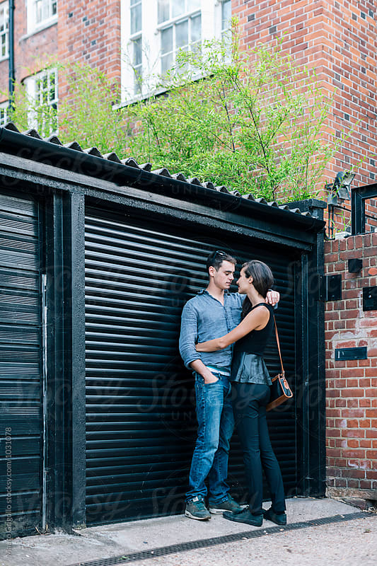 Couple flirting outdoor by Mauro Grigollo for Stocksy United
