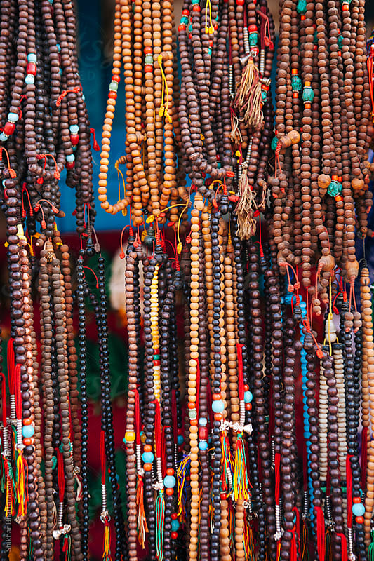 Religious beads for sale at a curio shop in Nepal. by Shikhar Bhattarai for Stocksy United