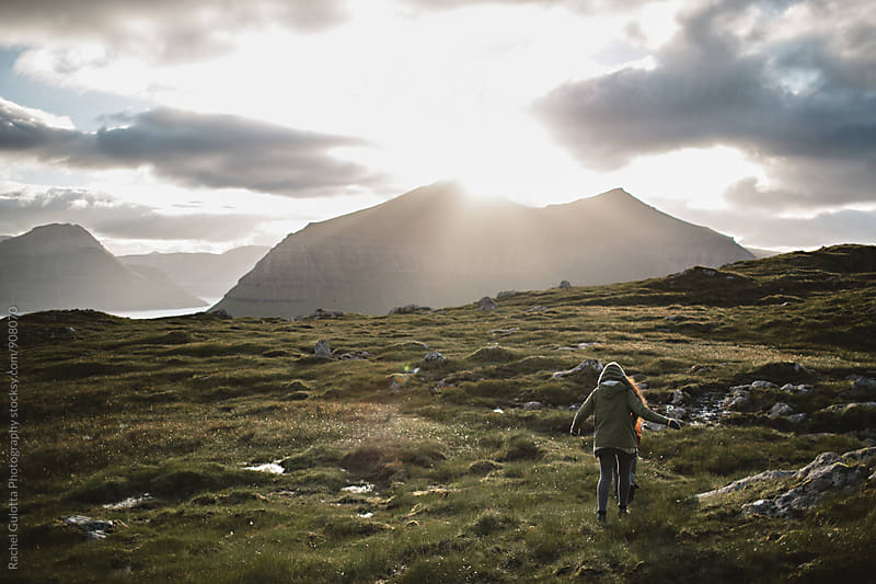 Travelers Exploring in Klaksvik Mountains in the Faroe Islands by Rachel Gulotta Photography for Stocksy United