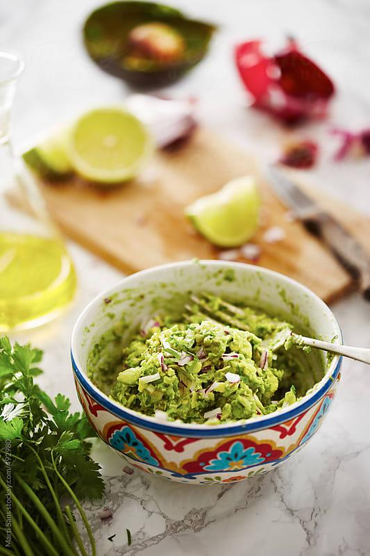Preparing guacamole by Martí Sans for Stocksy United