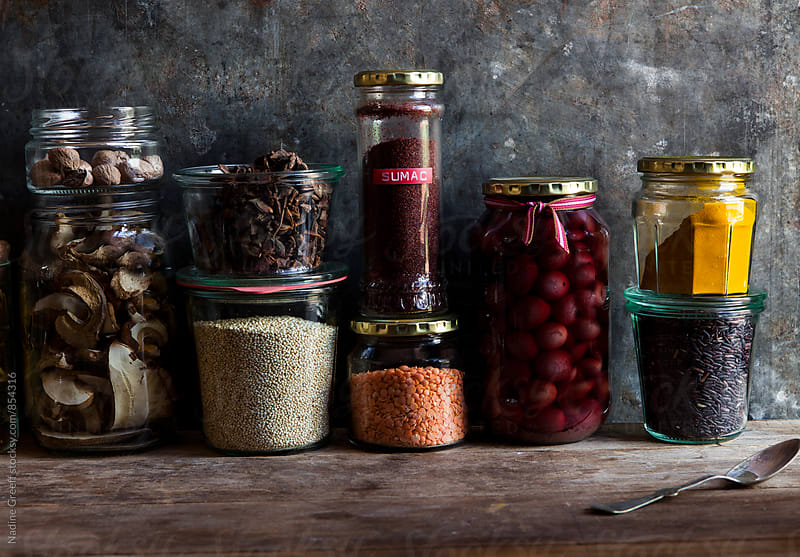 Kitchen spice and food storage jars by Nadine Greeff for Stocksy United