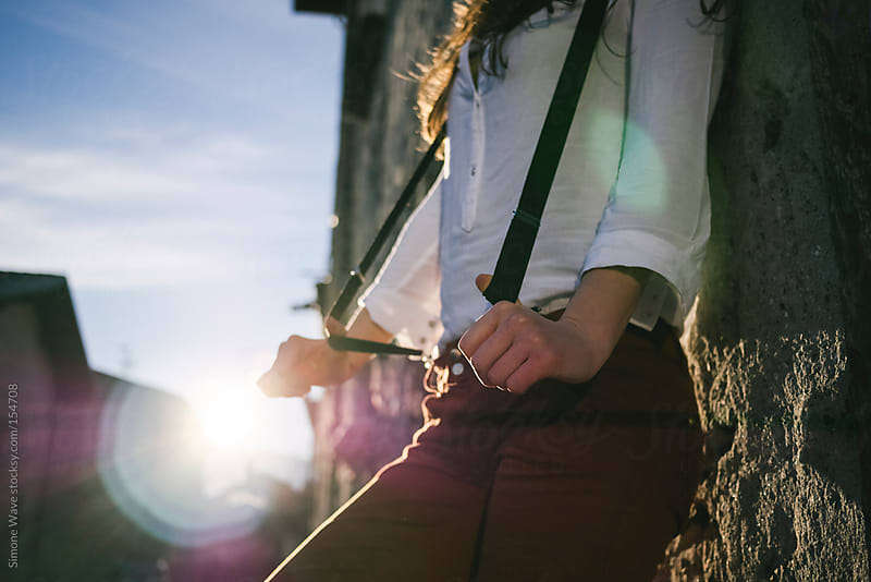 Young woman with suspenders outdoors by GIC for Stocksy United