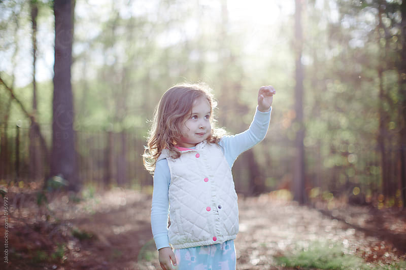 Happy toddler standing outside by a forest by Jakob for Stocksy United