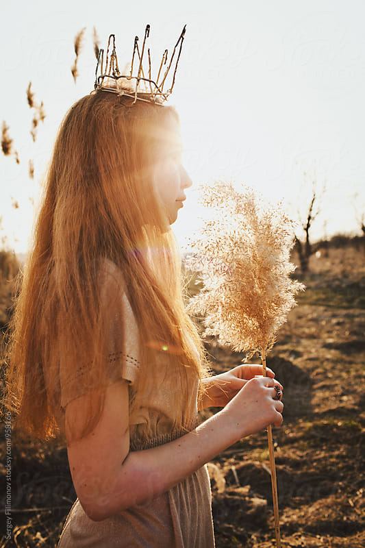 Portrait of a young red-haired beauty woman at sunset by Sergey Filimonov for Stocksy United