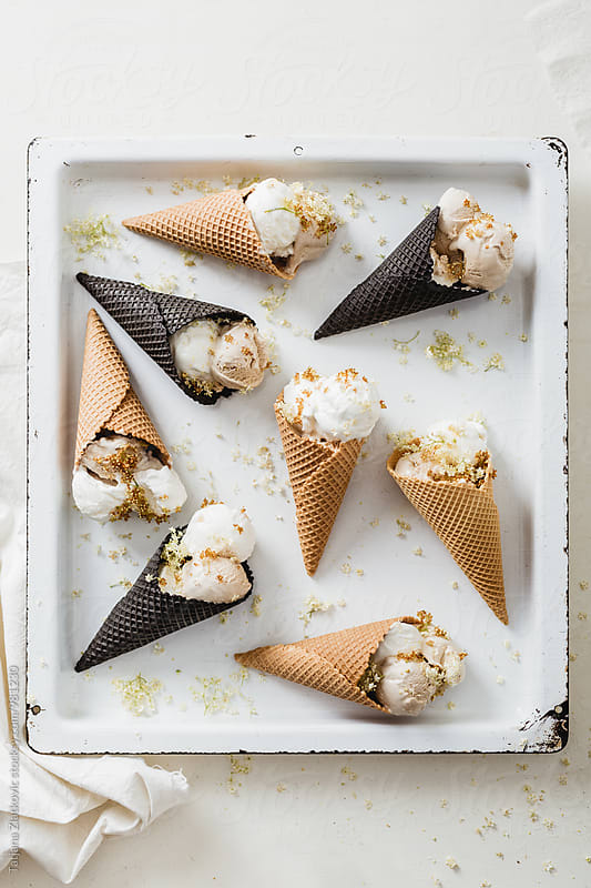 Frozen yogurt ice cream with elderflower and honey by Tatjana Ristanic for Stocksy United
