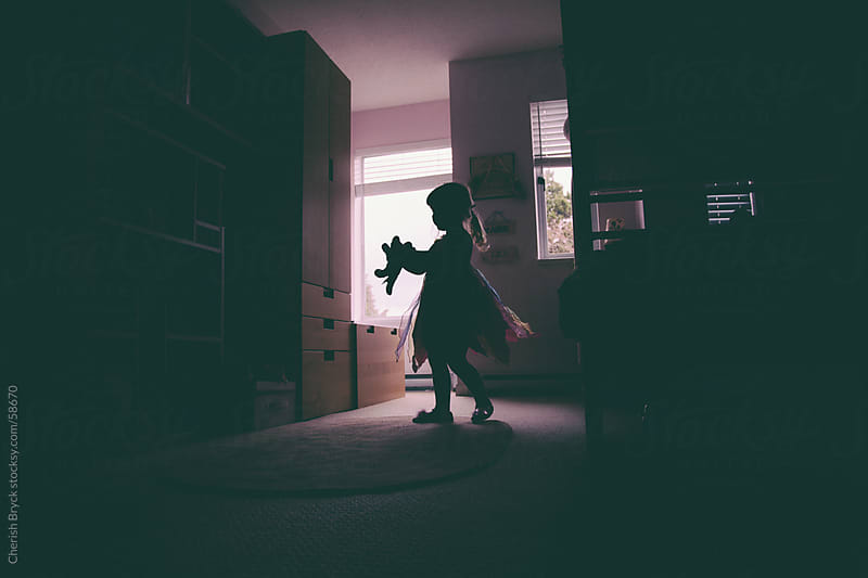 Little girl dancing in her room in silhouette. by Cherish Bryck for Stocksy United