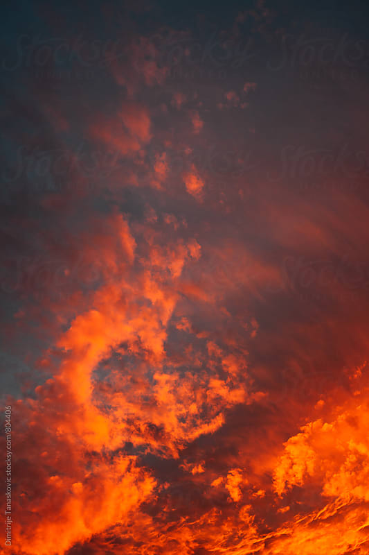 Dramatic red sunset in the sky by Dimitrije Tanaskovic for Stocksy United