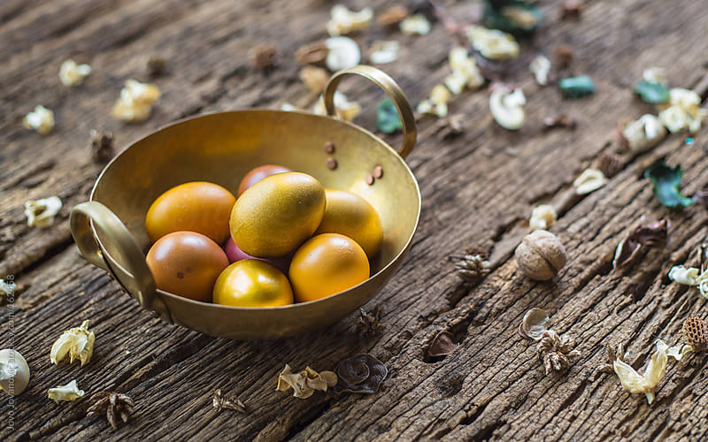 Golden Easter eggs in golden basket by Jovo Jovanovic for Stocksy United