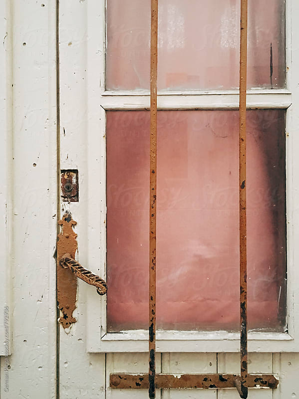 Detail of old door with glass in pink tone by German Parga for Stocksy United