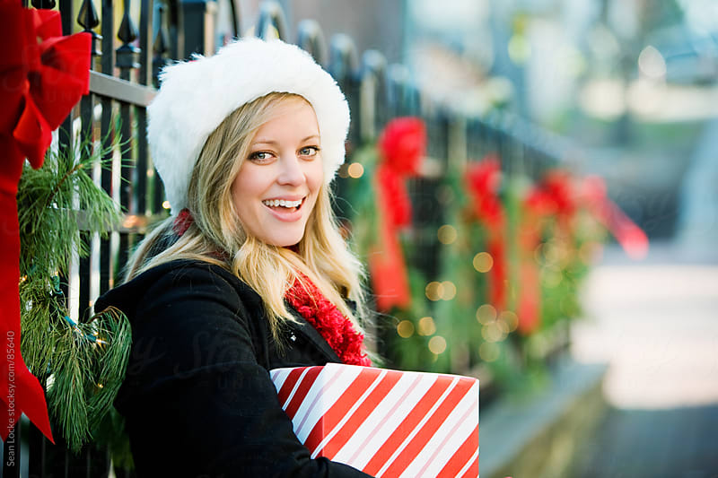 Christmas: Christmas Girl Holding Holiday Gift by Sean Locke for Stocksy United