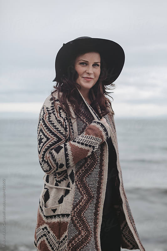 Beautiful young woman standing outside during west coast winter - portrait by Rob and Julia Campbell for Stocksy United