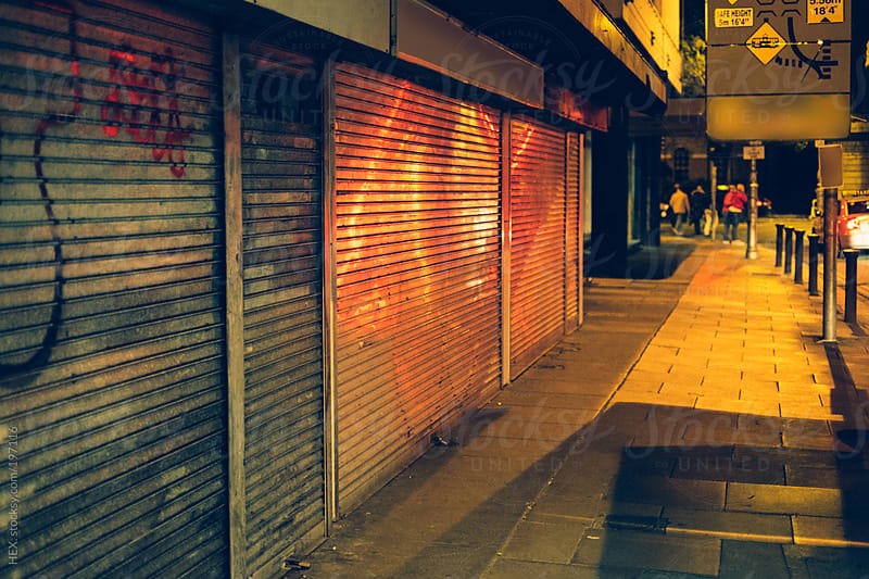 City Close Shutter Shop by Night by HEX. for Stocksy United
